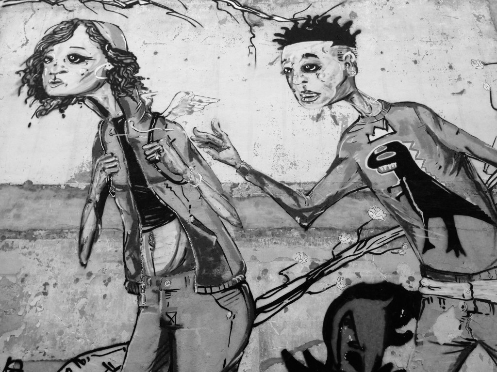 Langston Allston's mural can be seen in the graffiti hallway next to Pizza M/Flying Maching in downtown Urbana