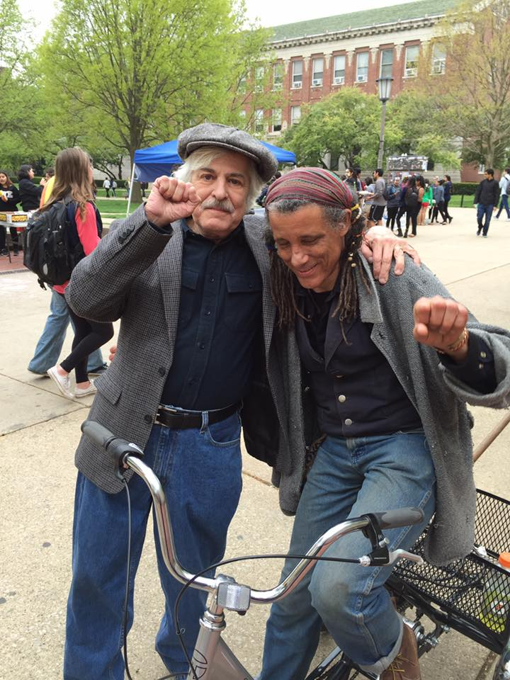 Gene Vanderport (left) at 2016 May Day rally with the Public i's Dave P.