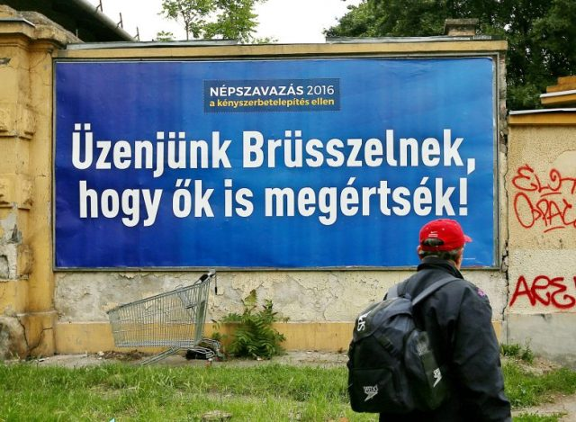 "Government anti-refugee referendum billboard. Text reads: ""Let's send a message to Brussels that they'll understand!"""