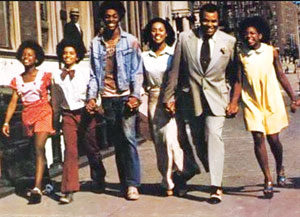 claudine-street-scene-whole-family
